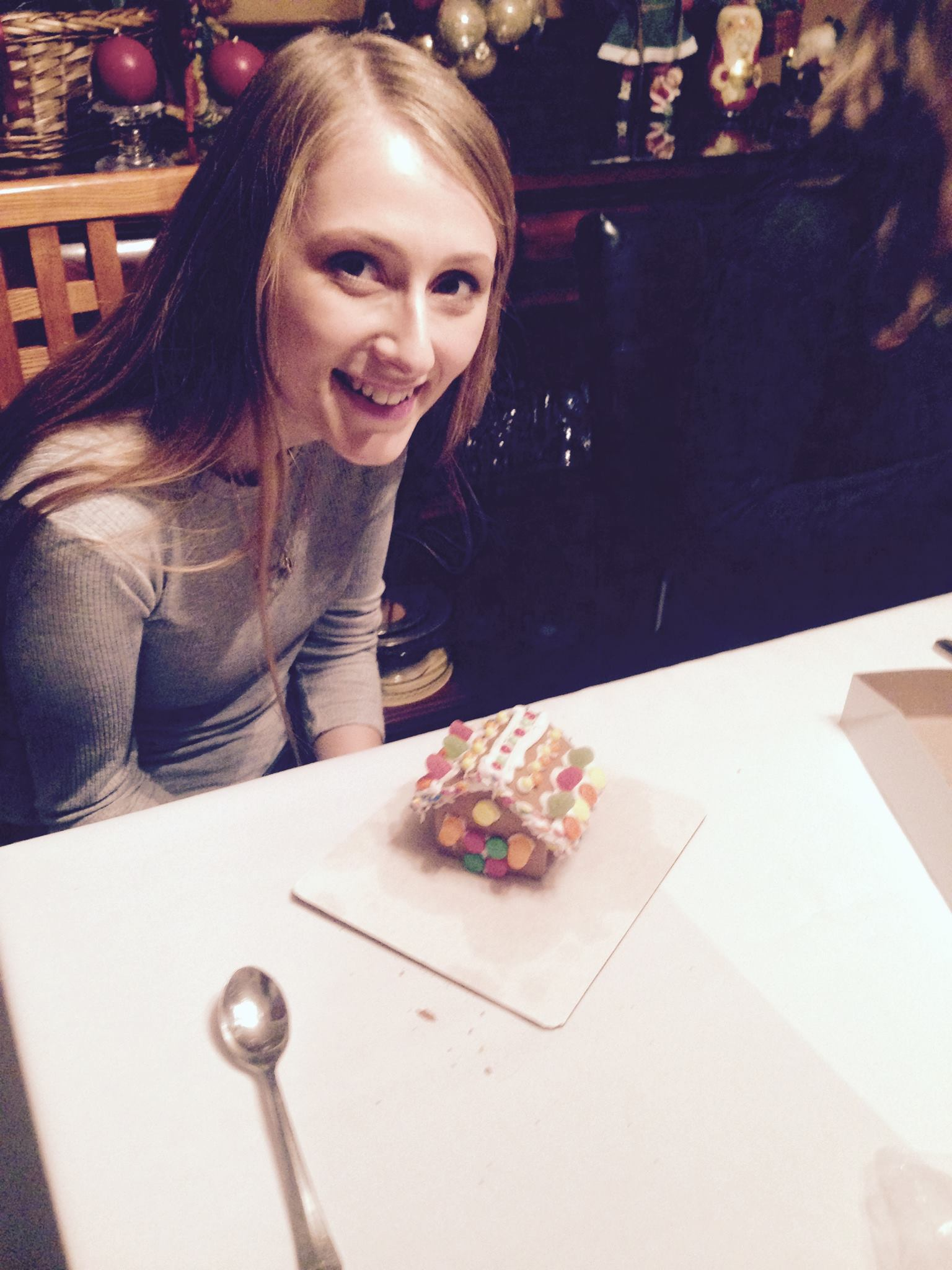 Sara Hall builds her gingerbread house at the 2016 lab holiday party.