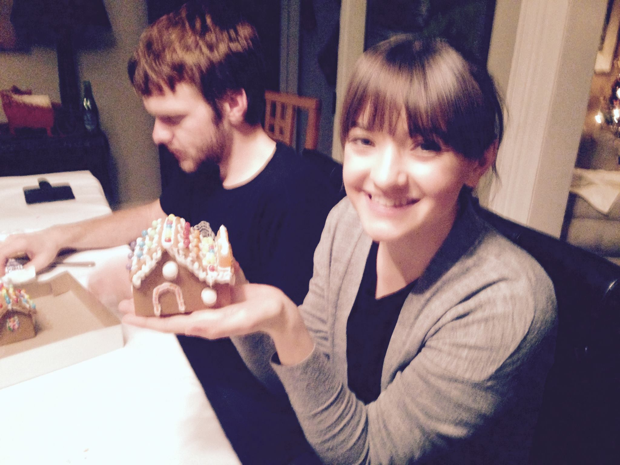 Madeline Peters and Colin Bonner working on their gingerbread houses at the 2016 lab holiday party.